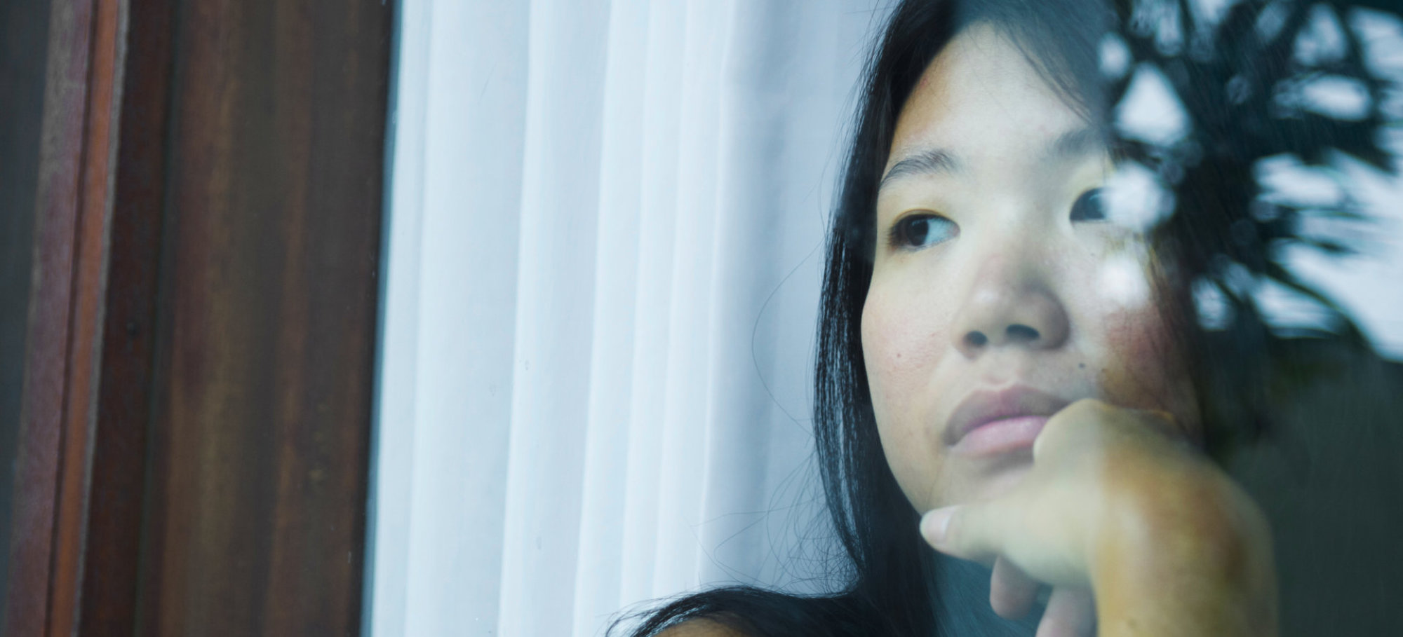 Sad and depressed Asian woman looking thoughtful
